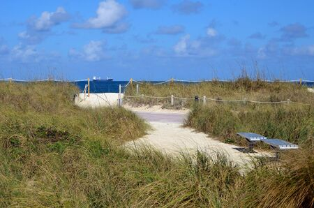 access point: Access point to the beach through a winding sandy path at Southpointe Park in Miami Beach,Florida Stock Photo