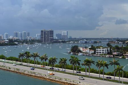 a view of the miami skyline,boats moored on the inter coastal ,star island and the macarthur causeway photo