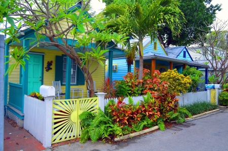 garden key: A row of colorful cottages on a quaint side street in an older district of Key West,Florida