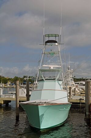rentals: Sport fishing boat available for charter moored at a marina in Coconut Grove,Florida Stock Photo
