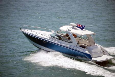 fishing cabin: Upscale sport fishing boat  headed towards the open ocean near Key Biscayne,Florida