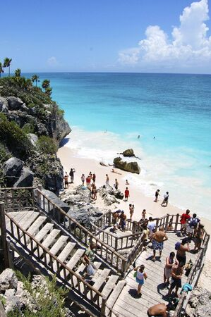 bathers: Wooden staircase from cliffs overlooking a white sand beach in Tulum,Mexico a popular cruise ship tour destination.
