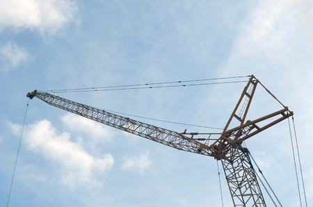 hoists: Construction crane towering over a hotel building site in Miami Beach,Florida Stock Photo