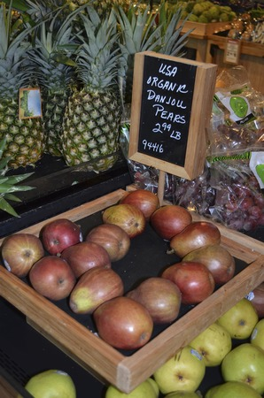 upscale: Organic pears on display at an upscale market. Stock Photo