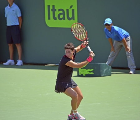 key biscayne: Carla Suarez Navaro preparing to hit a backhand during a rally with Andrea Petkovic in their quarter final match at the Miami Open in Crandon Park Tennis Center on Key Biscayne,Florida on 2 April 2015.  Ms. Suarez Navaro won in straight sets.