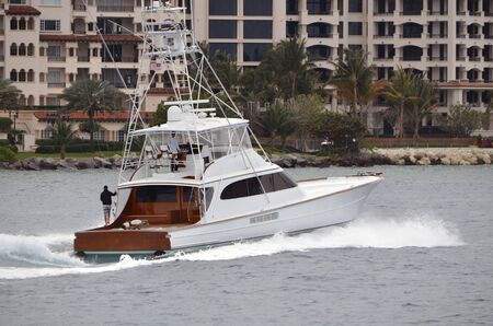 luxuries: Upscale Fishing Boat cruising on Government Cut inlet near Miami Beach,Florida Stock Photo