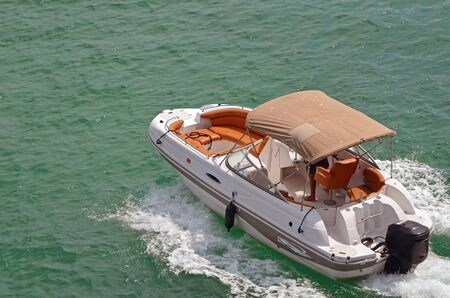 boat motor: Upscale outboard motor boat cruising on biscayne bay