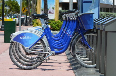 rentals: Rental bikes at a pick up station in miami beach,florida on 15 April 2016. Rental bikes are becoming an increasingly popular form of transportation for tourists and local residents alike. Editorial