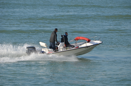Open motorboat powered by a single outboard engine  speeding across the florida intra-coastal waterway near Miami Beach,