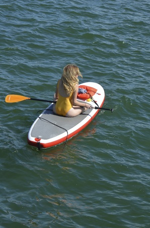 Woman resting on a paddle board in the intra-coastal waterway near Miami Beach,Florida Banco de Imagens