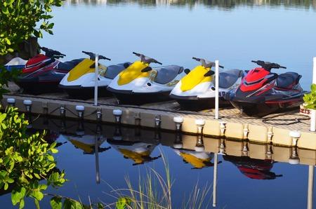 Jet skis on a floating storage dock at a centra florida resort,