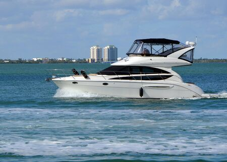 High-end white cabin cruiser on the Florida Intra-Coastal Waterway off Miami Beach. 写真素材