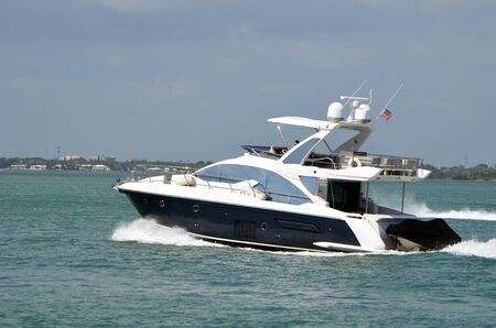 Well appointed cabin cruiser on the Florida Intra-Coastal Waterway off Miami Beach 写真素材