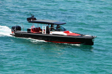 High-end motorboat cruising on the Florida Intra-Coastal Waterway off of Miami Beach