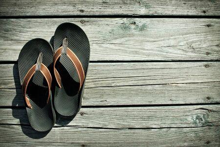 Flip-flops on deck photo