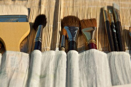 Perspective view of artists brushes in bamboo case