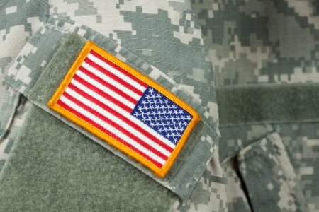 war and military: American flag patch on U.S. military combat uniform. Stock Photo