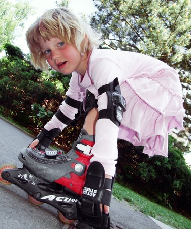 A girl with rollerskater Stock Photo