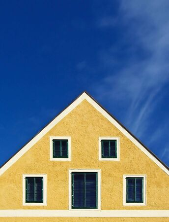a yellow house, a blue sky Stock Photo