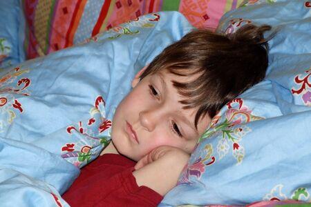 a boy in a bed
