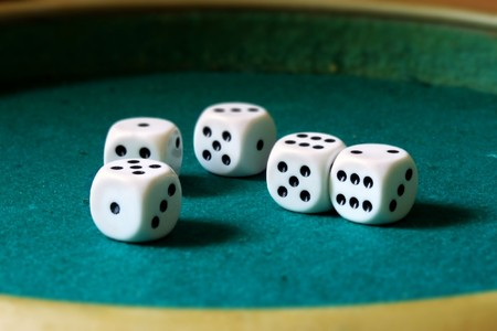 five dices on a board Stock Photo