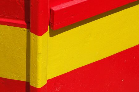 a piece from a boat, colors in red-yellow-red. the colors from the flagg from spain