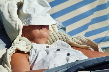 a woman rest in a deck chair