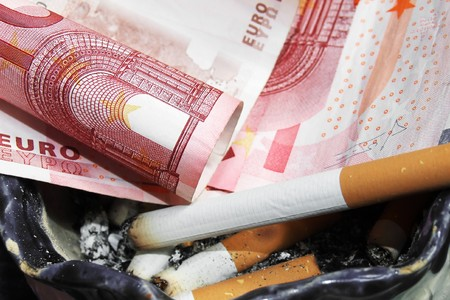 a cigarette with money