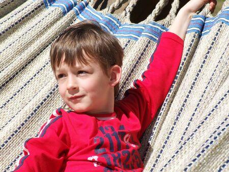a boy in a gigantic hammock Stock Photo
