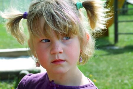 a young girl with pigtails Stock Photo