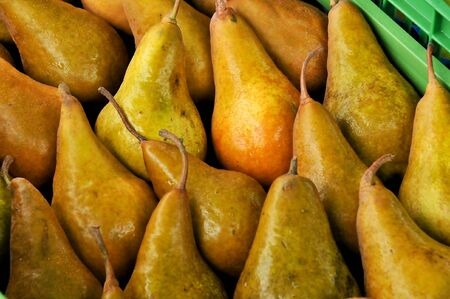 a few of pears side by side in a box Stock Photo - 5816076