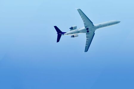 airplane. view from below. blue sky Stock Photo