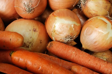 carrots and onions side by side Stock Photo