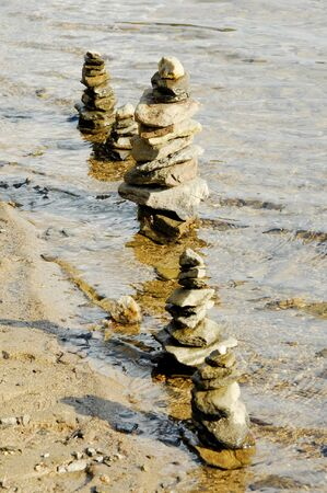cairn. a tower build with stones. this tower stands in the water