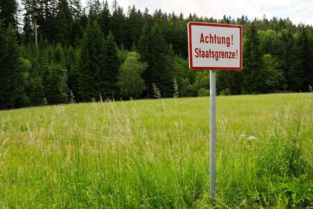iron curtain: A sign at a border with the writing Achtung Staatsgrenze - attention state frontier