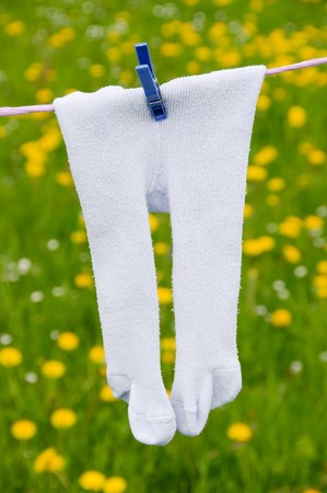 Tights on a clothingsline. Attached by clothing pin Stock Photo