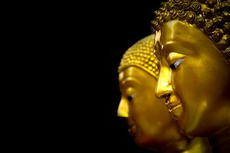 Close up Head of Golden Buddha Statue. Stock Photo