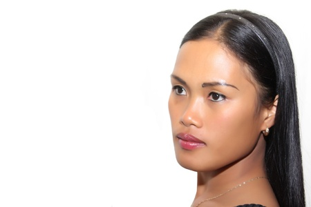 filipina: Close up portrait of a pretty Filipina against a pure white backround