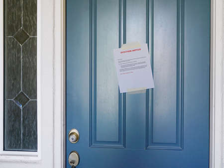 Wide ange view of Eviction Notice on door of home focus of sign