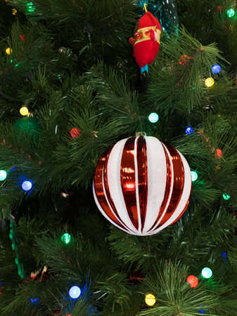 Red and White Ball Ornament on Lit Christmas Tree