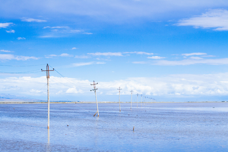 Power lines on mudflats Stock Photo