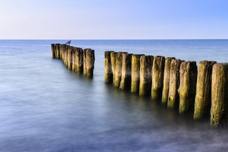 breakwater: Long exposure photo breakwater. Baltic sea shore.