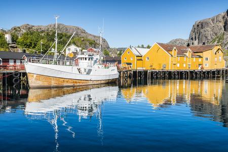 Fishing boat moored in the fishing port. Nusfjorden, Lofoten arcghipelago. Stock Photo