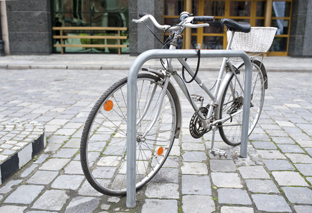 no name: Old, used urban gray bicycle parked in the street, no name cycle Stock Photo