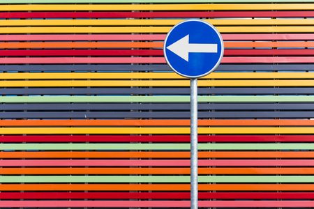 Road-sign on multicolored strips background.