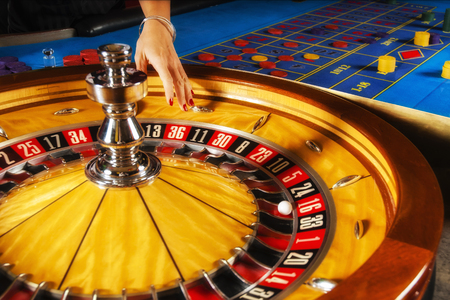 Roulette wheel and croupier hand. Stock Photo