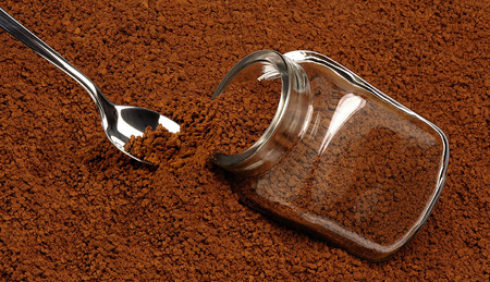 Coffee spoon inserted into granular instant coffee.