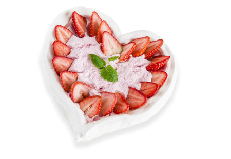 Meringue cake, with strawberries isolated on white.