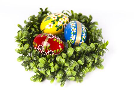 Easter eggs on green nest.
