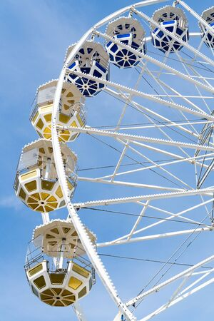 Ferris Mill, big  wheel on a background of blue sky.
